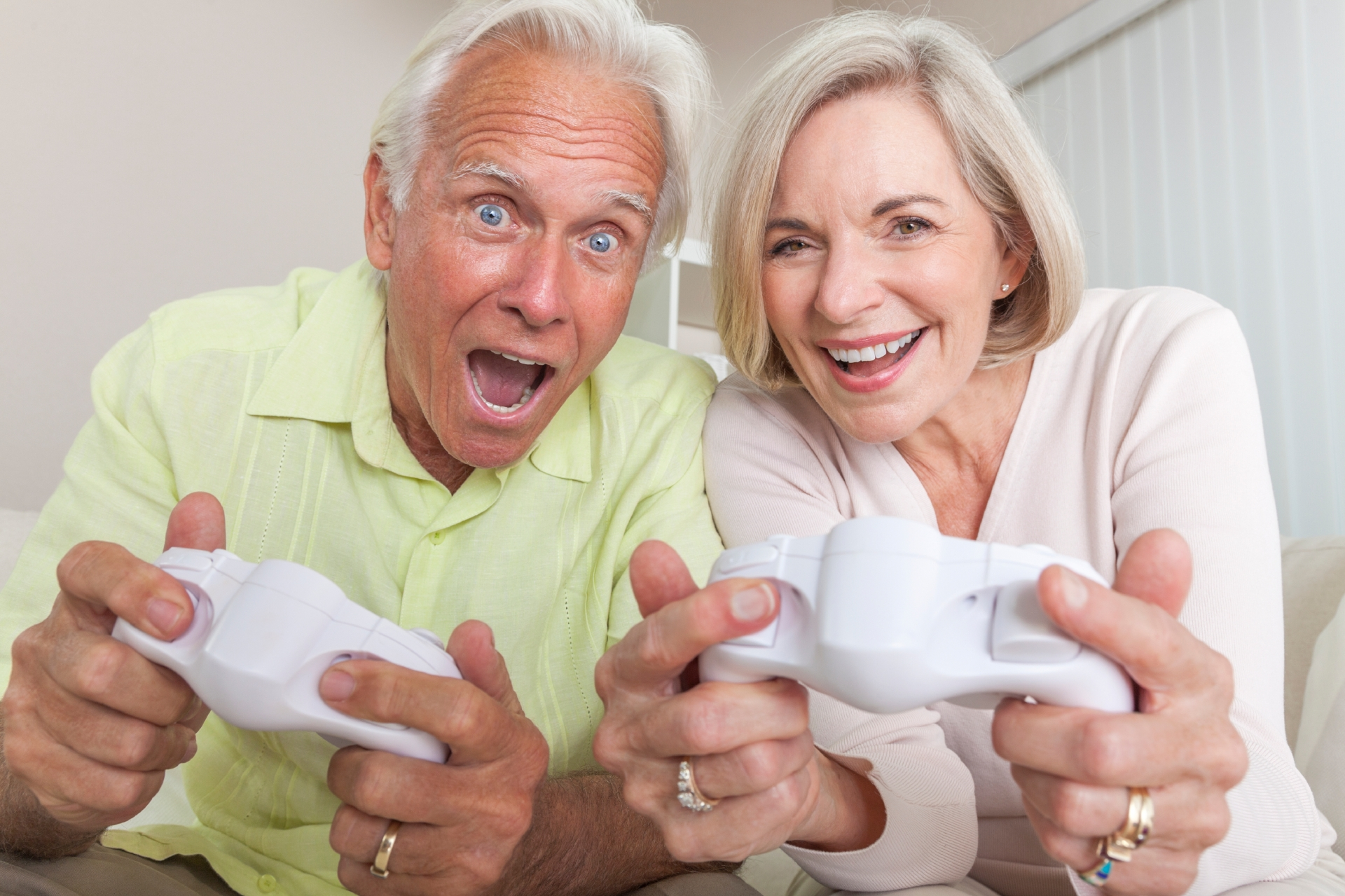 Senior Man & Woman Couple Playing Video Console Game